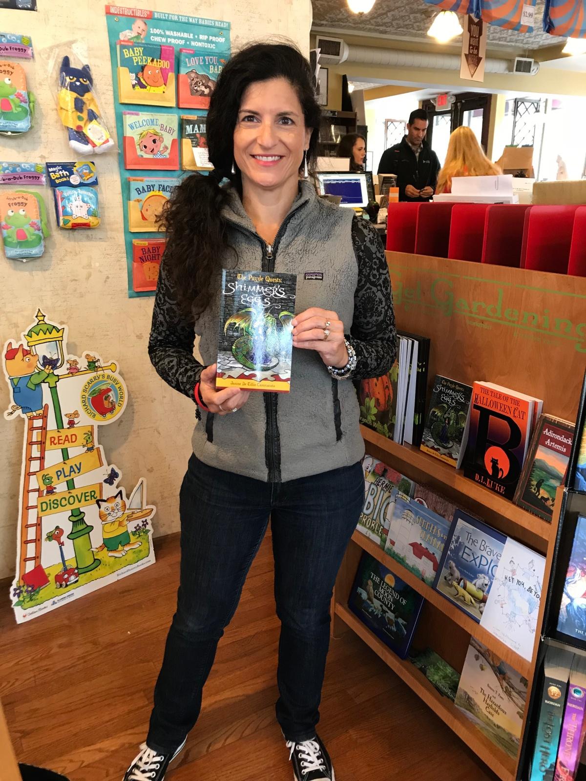 janineholdingbooktroybookstore